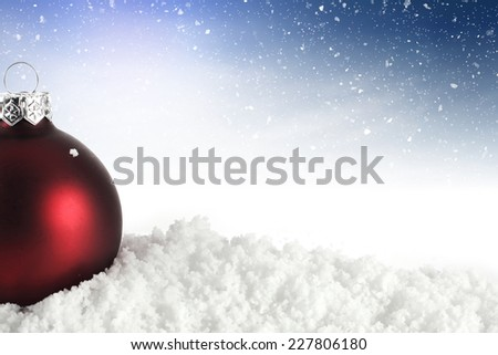 decoration of red holiday ball and snow with space for text