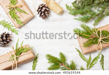Decoration of the tree branches, cones, gifts on wooden background #492619144