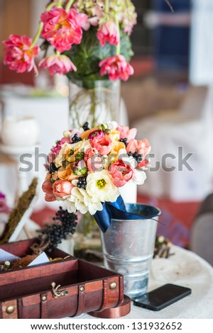 decoration of wedding table.floral arrangements and decorations.arrangement of hydrangeas and roses in vases