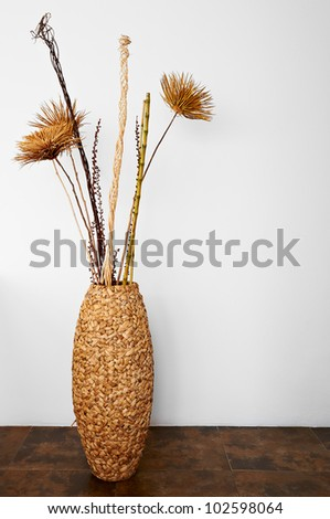 Decoration wicker basket with dry plants