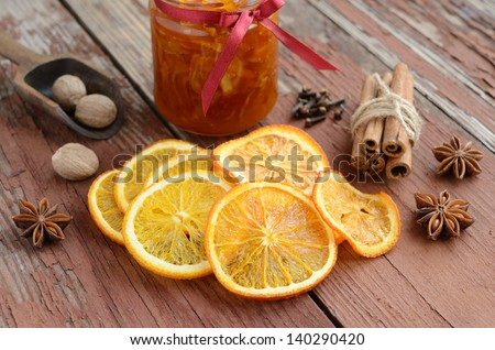 Decoration with dried orange peels, orange confiture and spices - cinnamon, nutmeg, cloves and anise stars
