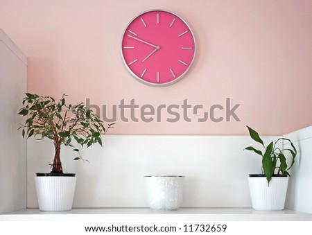 decoration with pink wall clock - stock photo