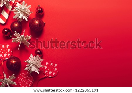 decoration with season greeting merry christmas prop on red background, glitter ball hanging with snow flake, top view of festival holiday party wallpaper #1222865191