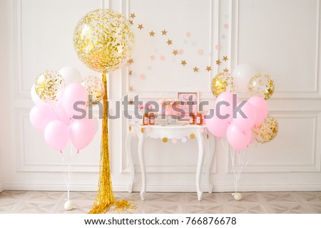 Decorations for holiday party. A lot of balloons pink and gold color.