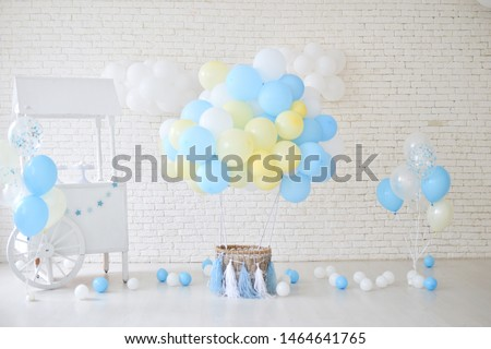 Decorations for holiday party. One year birthday decorations. A lot of balloons blue and yellow colors.