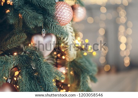 Decorations on a Christmas tree in New Year interior. Christmas and New Year concept #1203058546