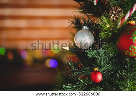 Decorations on christmas tree during christmas time at home #512686000
