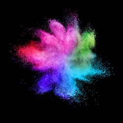 Decorative abstract chaotic colorful powder splash or explosion on a black background with copy space.