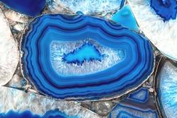 Decorative agate slab. Blue semi-precious stone. Abstract background for design.