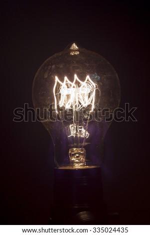 Decorative antique edison style light bulb in dark room #335024435