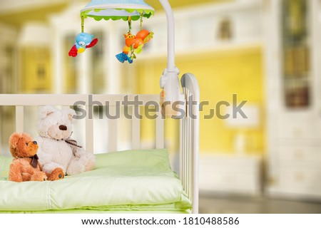 Decorative baby room interior and childbed with cute toys Stock photo ©