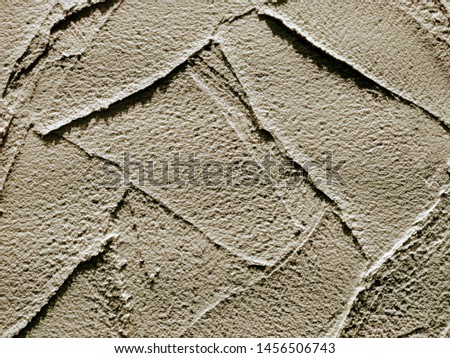 decorative background reminding decorative plaster or a decorative stone of beige color #1456506743