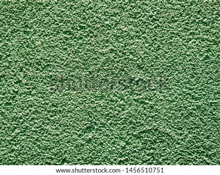 decorative background reminding decorative plaster or a decorative stone of greenish color or an old stone #1456510751