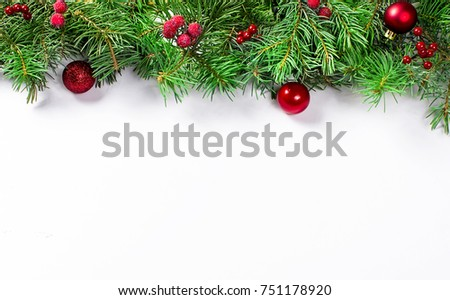 decorative background with fir branches, frozen berries and red balls on the white . Christmas card Holiday Concept. copy space, top view. #751178920