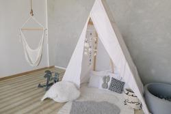 Decorative boho styled cozy hut with decor. Сhildren's room, Scandinavian style, minimal home interior design.