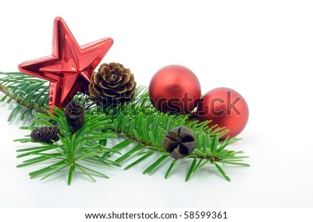 decorative branch with christmas balls isolated on white background