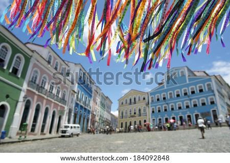 Decorative Brazilian wish ribbons waving in the sky above colonial architecture of Pelourinho Salvador Bahia Brazil