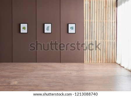 Decorative brown wall with wooden pattern and frame decoration empty nobody room.