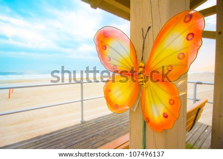 Decorative butterfly along beach in the summer