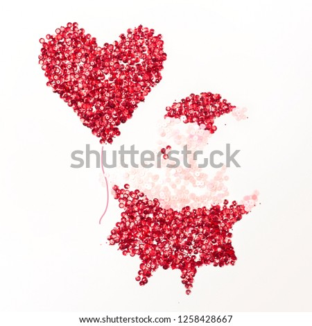 Decorative cartoon Santa Claus of red  and white sequins in his hand holds a heart-shaped balloon from sequins #1258428667