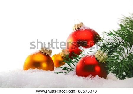 Decorative Christmas balls and Christmas tree on the snow.