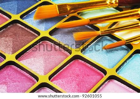 Decorative colorful eyeshadow and brushes , close up shot