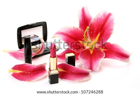 Decorative cosmetics and petals of pink lilies