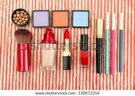 Decorative cosmetics on bright background