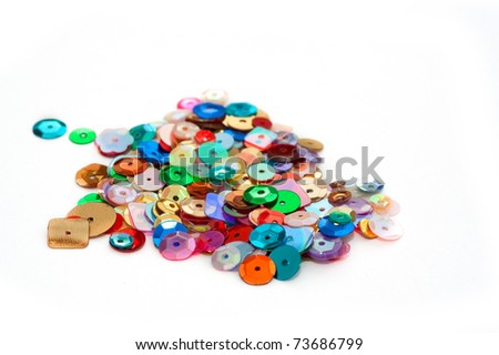 decorative craft sequins on a white background