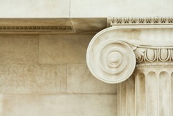 Decorative detail of an ancient Ionic column. close up.