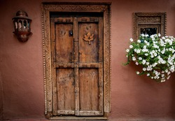 Decorative door of carved wood in Santa Fe, New Mexico.CR2