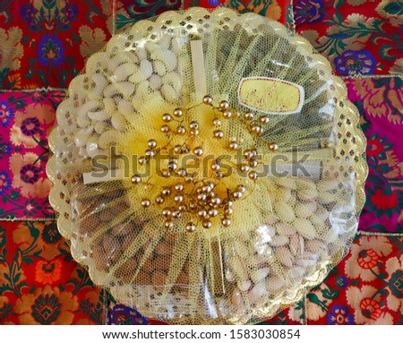 Decorative dry fruits packed containers. Dried fruit is dried, either naturally or through use of a machine, such as a food dehydrator. Raisins, prunes, and dates al