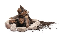 Decorative dry rotten branches in soil, dirt pile with rocks, wood for campfire isolated on white background