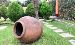 Decorative earthenware pot at garden. Earthenware is used extensively for pottery, tableware and decorative objects.