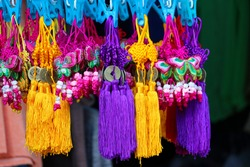 Decorative embroidery knots on display. decorative embroidery knots with ancient china coin design hanging on display. Decoration Knots for Chinese new year. They are sold in Chinatown.