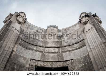 Decorative entrance carved in marble and stone on cloudy day