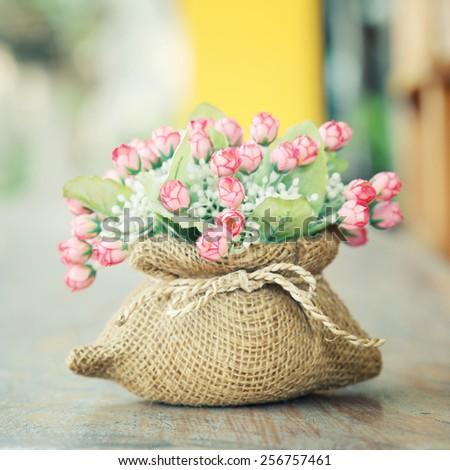 Decorative flower  on desk .Vintage.Soft focus