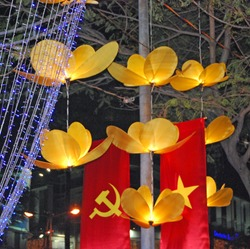 Decorative flowers mix with communism during the tet festival in Ho Chi Minh City (Saigon) Vietnam.
