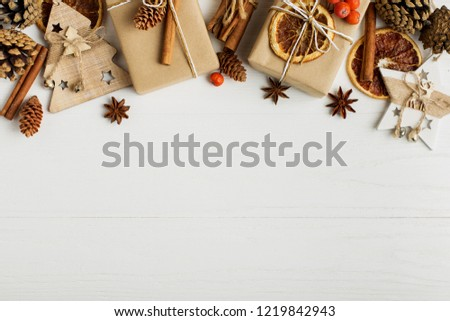 Decorative frame, christmas attributes on a white wooden table. Place for text, blank for postcard. Copy space. #1219842943