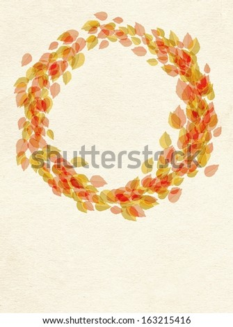Decorative frame of leaves arranged in a circle, wreath on textured paper background