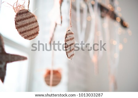 Decorative garlands. Decorative curtains on windows #1013033287