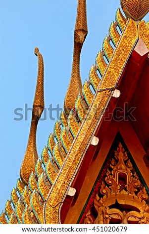 Decorative glass Naga Statue on the roof of chruch in Thai temple