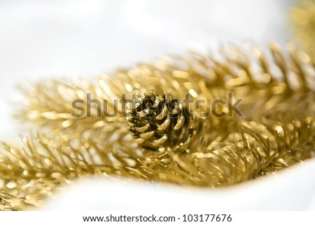 Decorative golden branch with pinecone