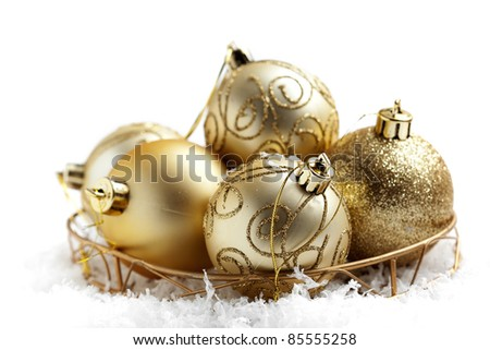 Decorative golden christmas baubles with selective focus