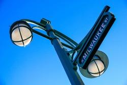Decorative Green Streetlight on Milwaukee St in Third Ward Milwaukee against Blue Sky