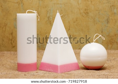 Decorative Handmade candles in the shape of a pyramid, cube, cylinder and sphere