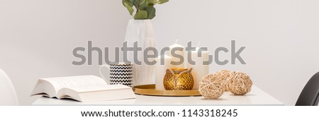 Decorative home accessories in scandinavian style lying on white table, panorama #1143318245