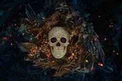 Decorative human skull on dark natural mistery background. magical esoteric ritual. symbol of Halloween, samhain sabbat. Mysticism, divination, wicca, occultism, Witchcraft concept. flat lay