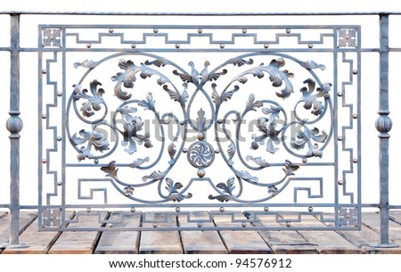 Decorative iron fence section with wooden floor isolated on white