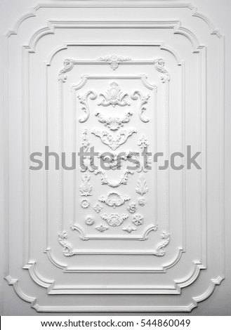 Decorative item made of white plaster on wall. Relief stucco interior #544860049
